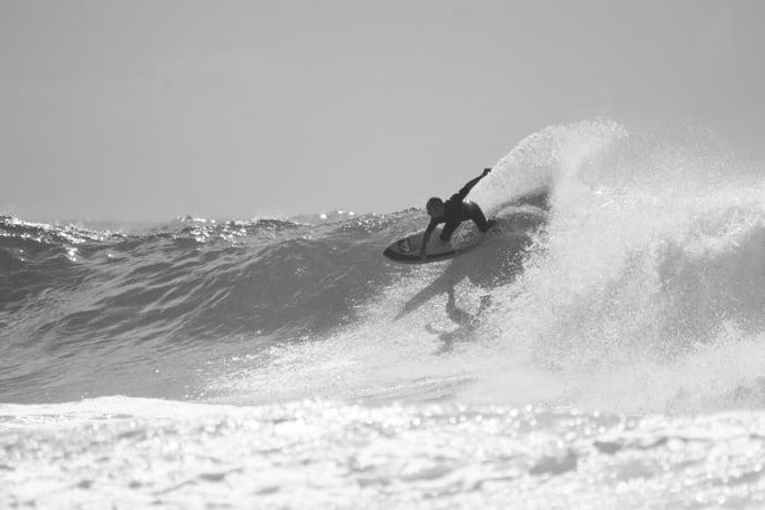 tom carroll surfing an eye symmetry cali quad hybrid surfboard