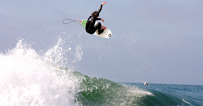 surfer getting air on a nation surfboard